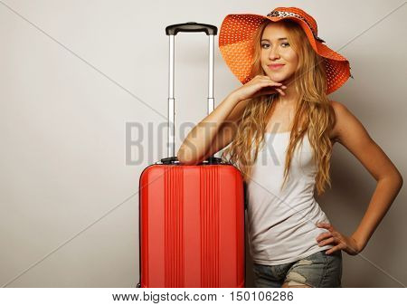 young woman  with orange travel bag