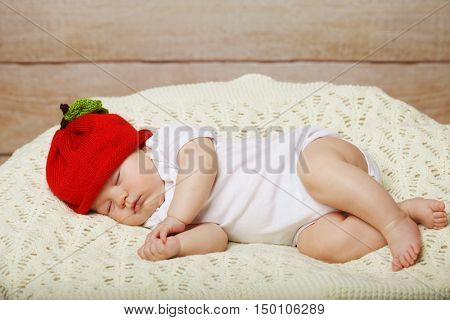 baby lying on a bed while sleeping