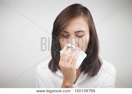 Asian caucasian woman with flu Cold Concept with Healthcare And Medicine.