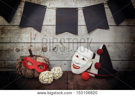 Vintage clown mask and hat, masquerade party background