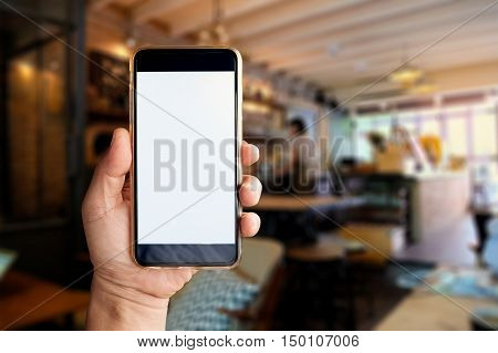 man hand holding empty screen of smart phone device in cafe.