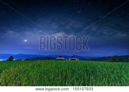 Milky way galaxy with stars and space dust in the Green Terraced Rice Field in Pa Pong Pieng Mae Chaem Chiang Mai Thailand