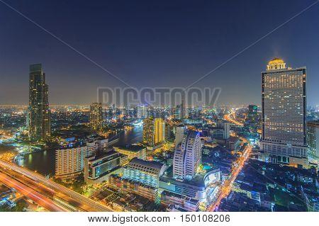 Modern building at riverside in twilight scene at Bangkok Thailand