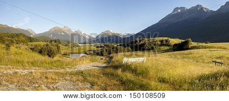 View of Humboldt Range and Forbes Mountains from Paradise. Paradise is 20km northwest of Glenorchy and lies beside the Dart River, offering scenic views of the Humboldt Range and Forbes Mountains with Mt Earnslaw, NZ