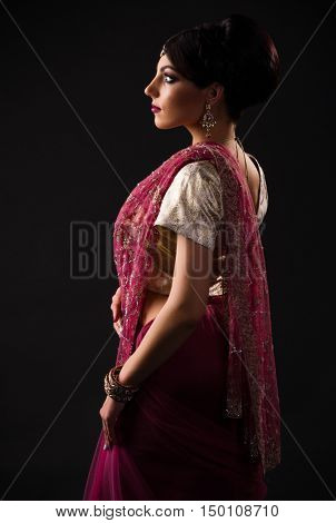 Young indian woman on grey
