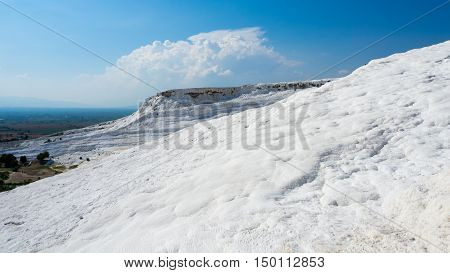 """PAMUKKALE DENIZLI TURKEY- SEPTEMBER 14 2016: Pamukkale meaning """"cotton castle"""" in Turkish is a natural site in Denizli Province in southwestern Turkey. The city contains hot springs and travertines."""