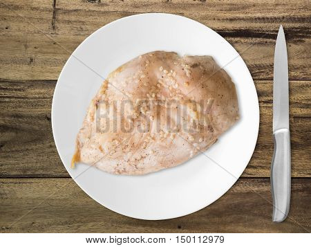 Boiled chicken breast with knife ready to eat. Clean protien food.