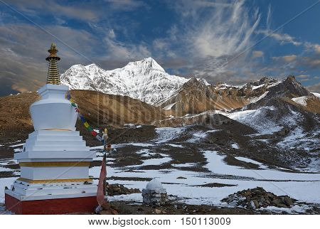Hiking photographer taking pictures. Himalaya, Nepal. Trek around Annapurna mount