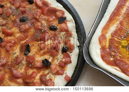 pizza alla marinara with fresh chopped tomatoes anchivies and black olives