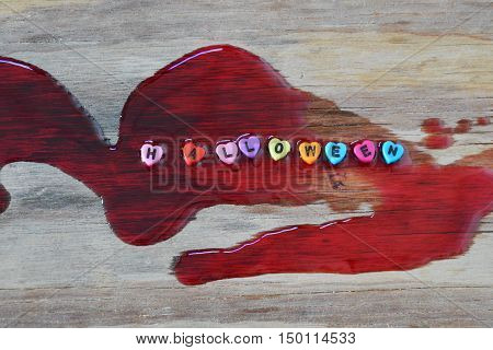 Halloween letter on blood at wooden board