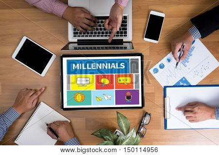 MILLENNIALS Business team hands at work with financial reports and a laptop top view poster