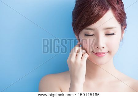 beauty skin care woman relax closed eye isolated on bluebackground asian