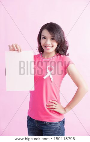 Happy woman hold paper with pink ribbon great for prevention breast cancer concept poster