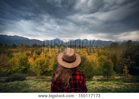 Woman At Autumn Mountains Landscape