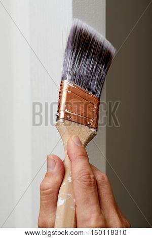 Hand with a paint brush.