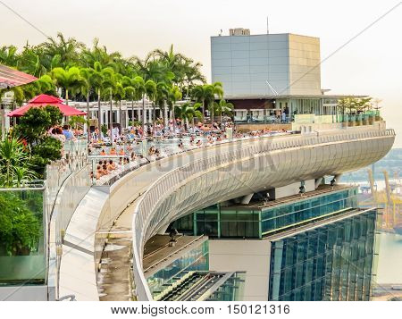 SINGAPORE, REPUBLIC OF SINGAPORE - JANUARY 09, 2014: World's largest rooftop Infinity Pool on the top of Marina Bay Sands Hotel