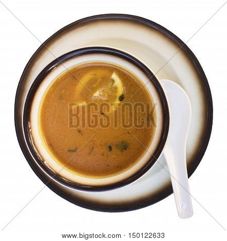 A photo of a bowl of chicken soup with lemon, isolated on white