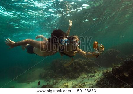 Couple is making photo underwater