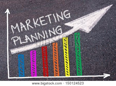 Marketing Planning Written Over Colorful Graph And Rising Arrow