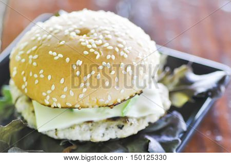 pork burger with cheese and vegetable dish