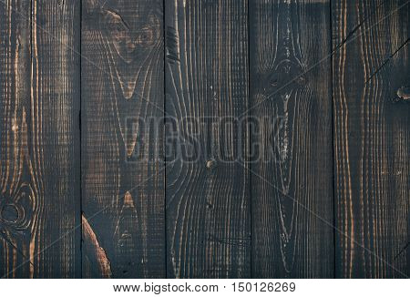 Old dark scorched wood texture, wallpaper and background