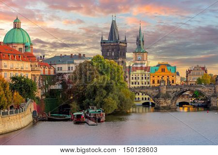 Famous Prague Landmarks - towers and bridge at sundown time with beautiful sky, Prague, Czech, Europe