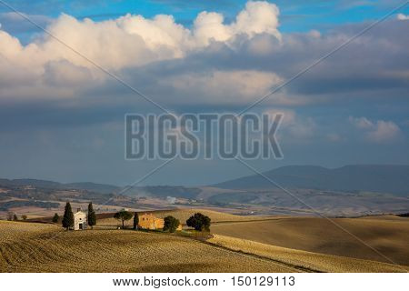 Famous Tuscany Landmark - Chapel of Madonna di Vitaleta, Beautiful Landscape at the evening time. Tuscany, Italy, Europe