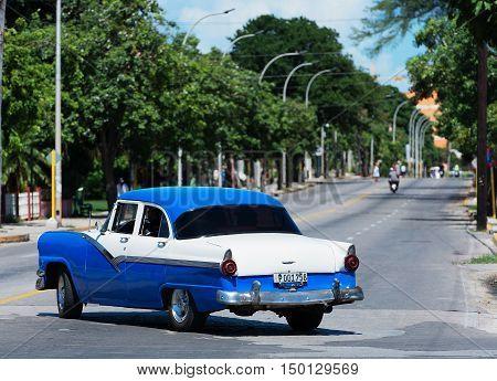 Varadero, Cuba - September 11, 2016:  blue American Classic Car Dirves in Varadero City, Cuba