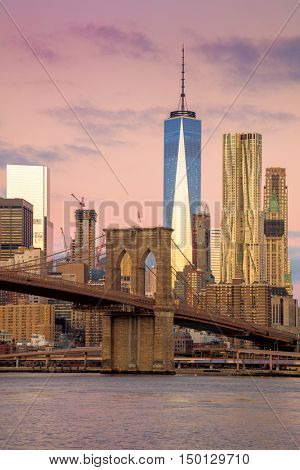 Morning colors of famous New York Landmarks - Brooklyn Bridge and  Manhattan offices skyline, New York City,  USA