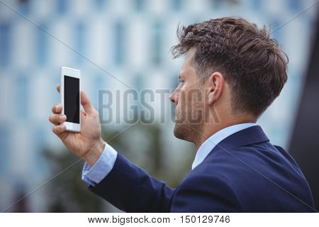 Close-up of businessman using mobile phone
