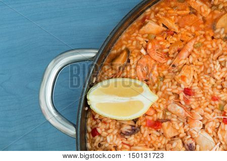 Spanish food. Seafood paella on a wooden blue background