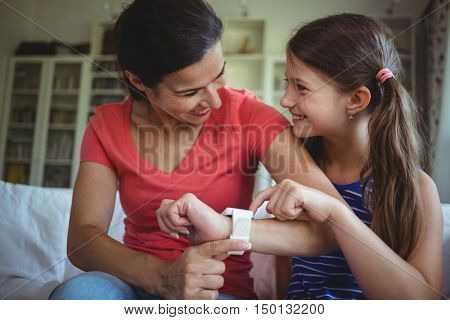 Close-up of smiling mother and daughter looking face to face