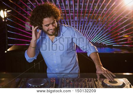 Male DJ playing music at the nightclub