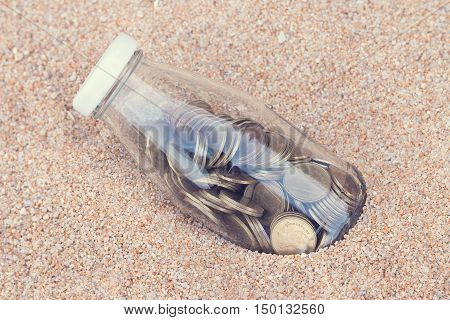 Coins savings for travel in the beach Vintage style