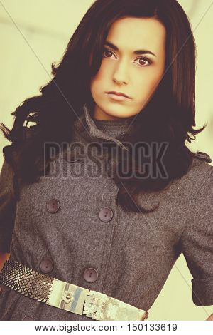 Beautiful young brunette fashion woman