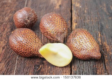Salak Sala Palm Closeup Asian fruit (Salacca zalacca) on the wooden floor background