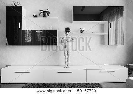 child doing yoga on the furniture. Yoga