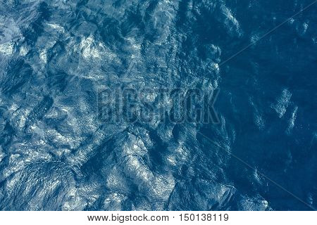 Deep blue water background in blue - just waves.