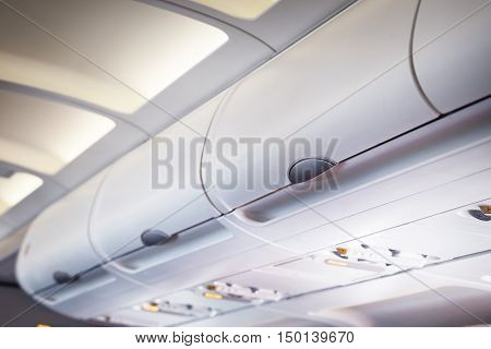 The luggage compartment in an airplane above passenger