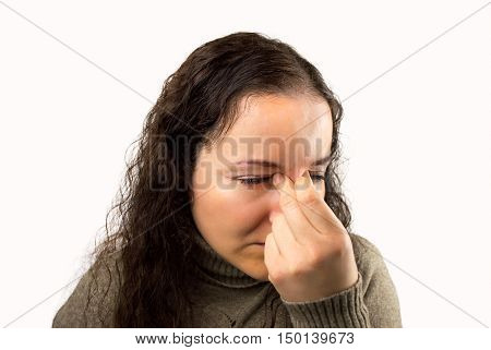 tired and eyestrain woman with white background