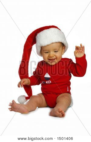 Small Boy In Santa Claus Cap