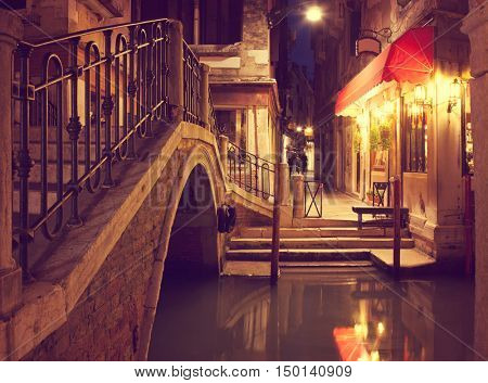 Narrow canal in Venice at night, Italy.  Ponte dei Ferai . Toned image