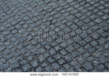 Geometry Pattern Background Of Cobblestone Pavement With Moss