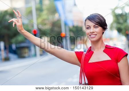 Businesswoman trying to catch a taxi