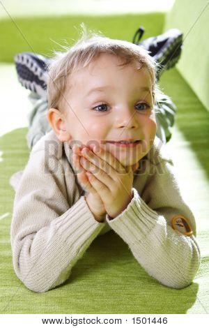Little Boy On A Sofa.
