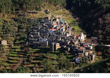 Small village in Portugal, where its schist houses are the main attraction. In the distance the village looks like a crib in the middle of the mountain.