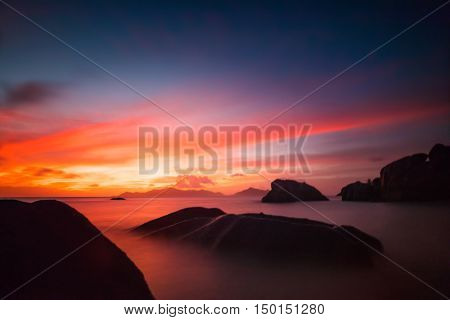 Beautiful Seychelles tropical beach Anse Source D Argent at La Digue island in sunset dark light