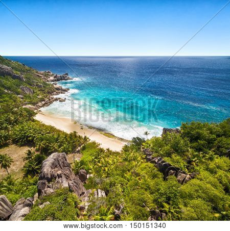 Beautiful Seychelles tropical island with typical granite rocks and sandy beach
