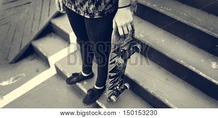 Young Woman Skateboard Standing Outdoors Bridge Concept