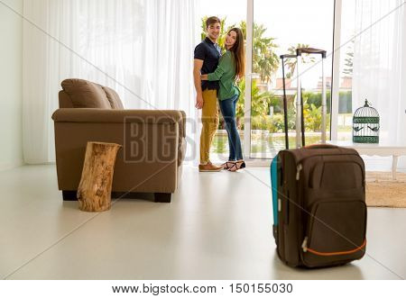 Young couple arriving the hotel for holidays